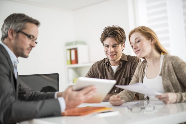 couple talking to a real estate broker