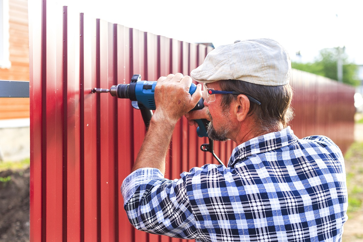 man installing fence