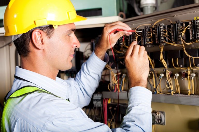 electrician checking the fuse box