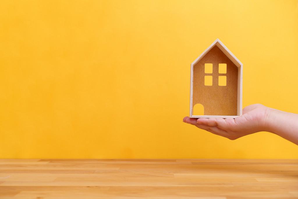 holding miniature house