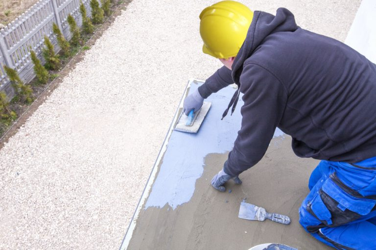 man working on paint