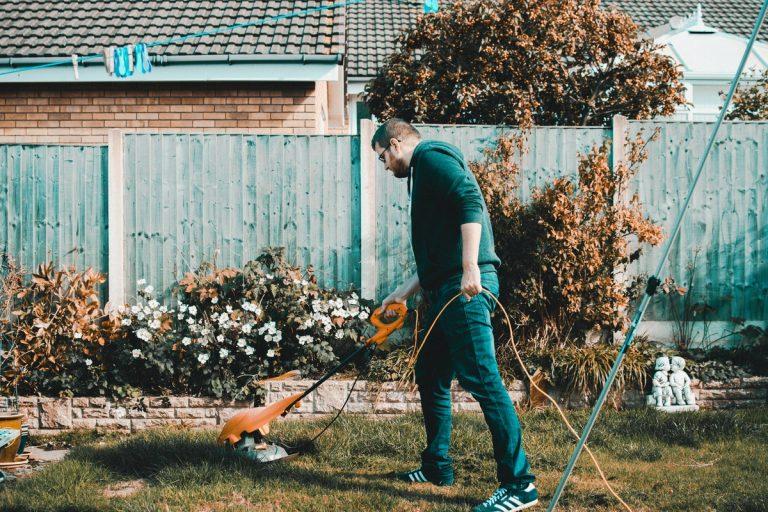 person cutting lawn grass