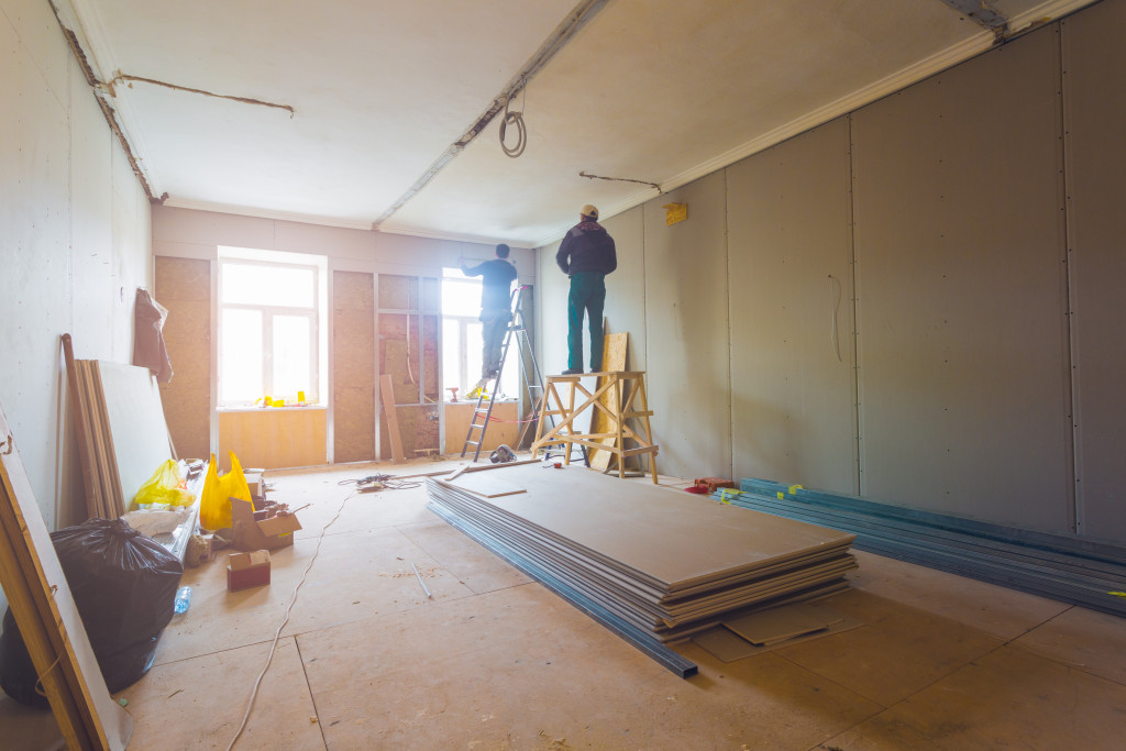 workers renovating a house room