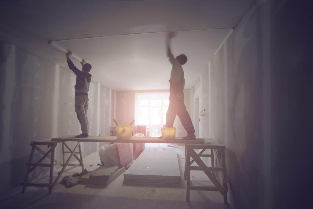 workers renovating a house
